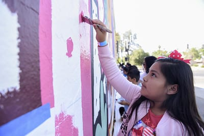 Student Painting a Mural